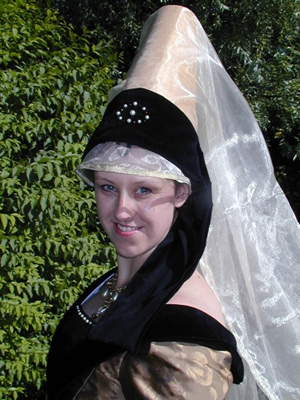 Gold Brocade Truncated Steeple Hennin, with Black Velvet Frontlet and Knee Length Veil