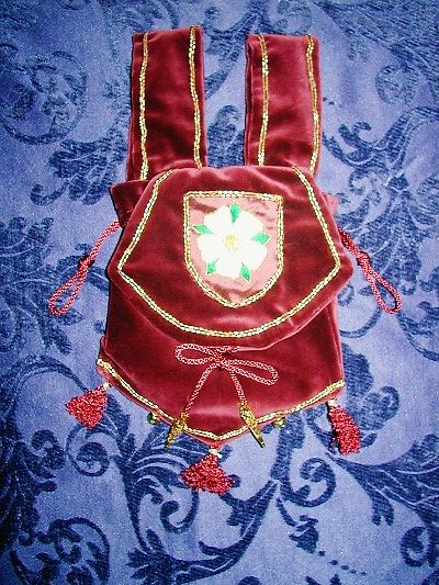 Burgundy velvet pouch embroidered with the White Rose of York emblem