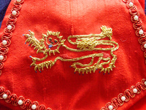 Detail of Red Velvet Pouch with Goldwork Leopard of England