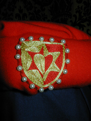 Detail of Heraldry showing Embroidery and Goldwork on Red Silk